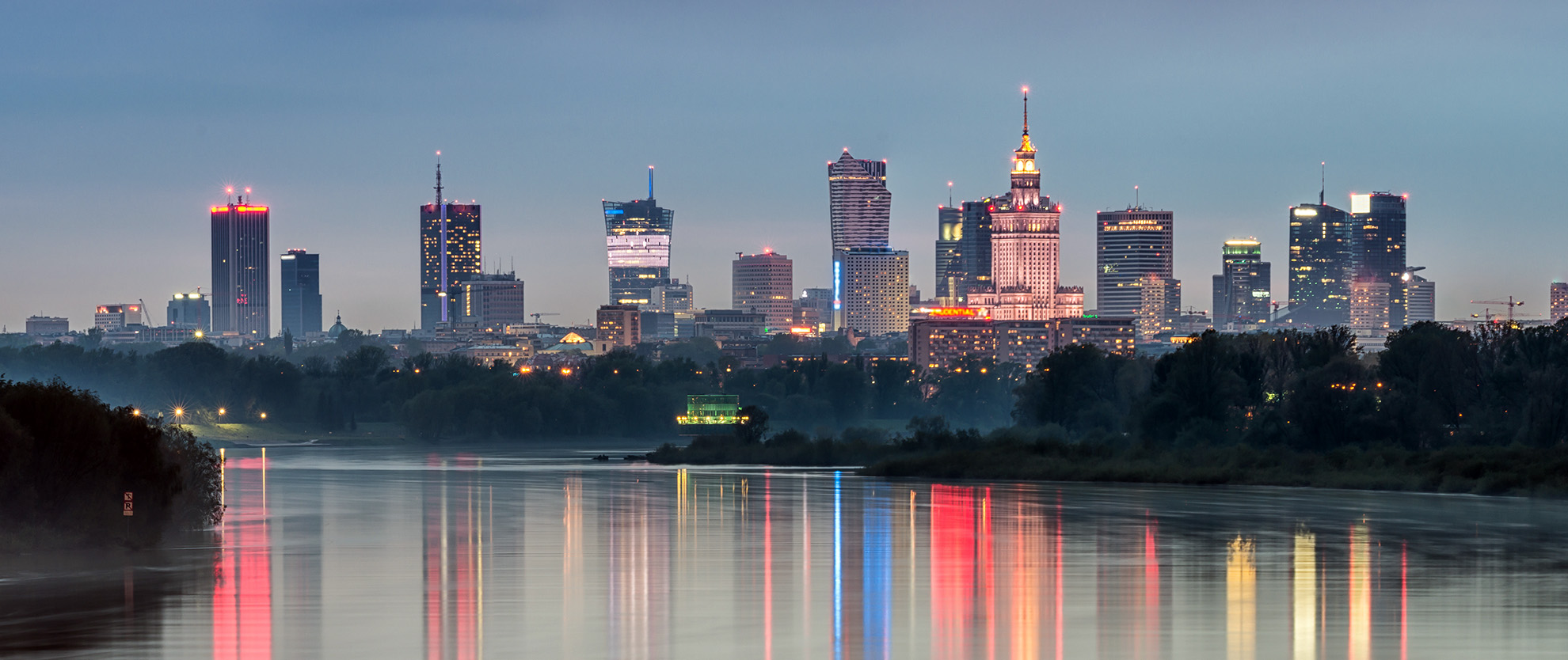 Night panorama of Warsaw skyline, Poland, over Vistula river in